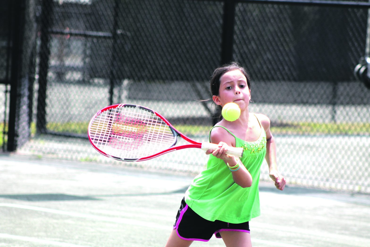 Back-handed Fun: Cooper Family  Soaks Up Some Tennis At McCluskey