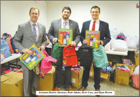 District Attorney's Office  Delivers Backpacks to TCSS